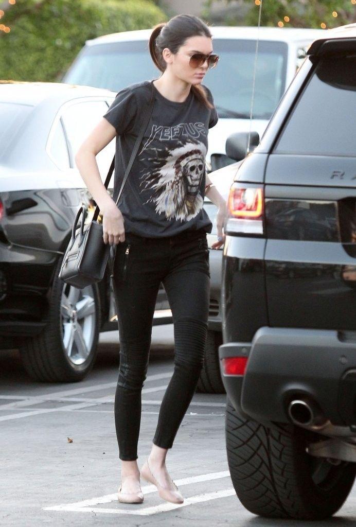 Kendall Jenner wearing Celine Nano bag Yeezus Tour Merch Indian Headress T-Shirt Chloe Scalloped Flats