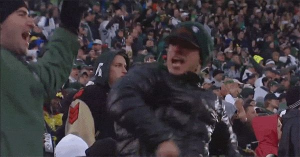 Michigan State Fan Celebrates Sack By Smacking His Friend in the Face: Michigan State's defense is beating up Devin Gardner and the Michigan Wolverines. The Spartans defense has notched seven sacks and held their in-state rivals to -59 rushing yards through three quarters. This defensive success has fans eager to get in on the hitting, which is precisely what this guy accomplished thanks to his unsuspecting buddy.