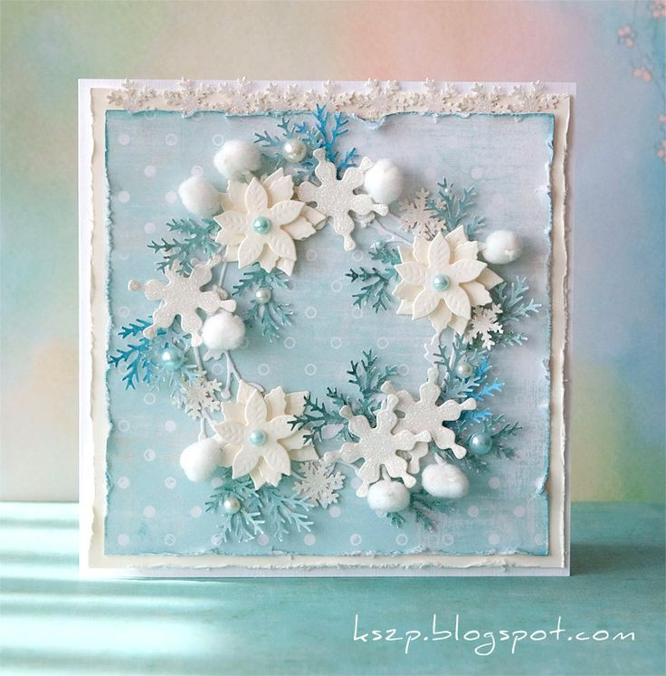 handmade card ... Handgjorda kort ... wreather made up of die cuts/punched elements ... white an blues ... poinsettias ... snowflakes ... cotton balls ...