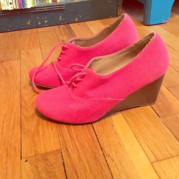 Hot pink lace-up wedges Hot pink/coral color, really cute! There's some wear at the back, but it's unnoticeable while wearing. Run small for an 8. Shoes Wedges