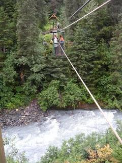 Hand tram-you pull yourself by the rope across a 200 ft. drop over Winner Creek off Winner Trail in Girdwood, Alaska.