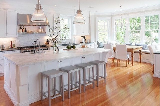 warm and welcoming kitchen design with wood floor and marble