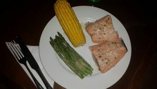 Salmon fillets grilled in foil with lemon butter and garlic, and parmasian cheese sauce. Asparagus grilled with parmasian cheese in foil and a boiled millie.