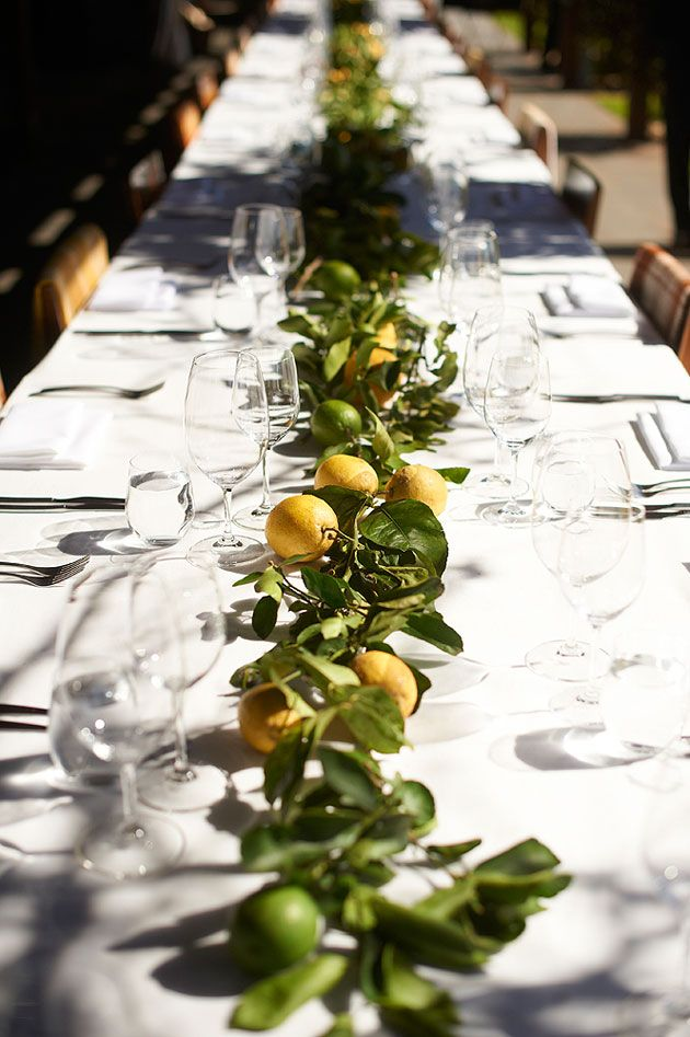 Lemons and limes with foliage as centerpiece decor. Perfect for long tables AND budgets....do it with oranges to stay in Florida theme and create a wonderful smell :)