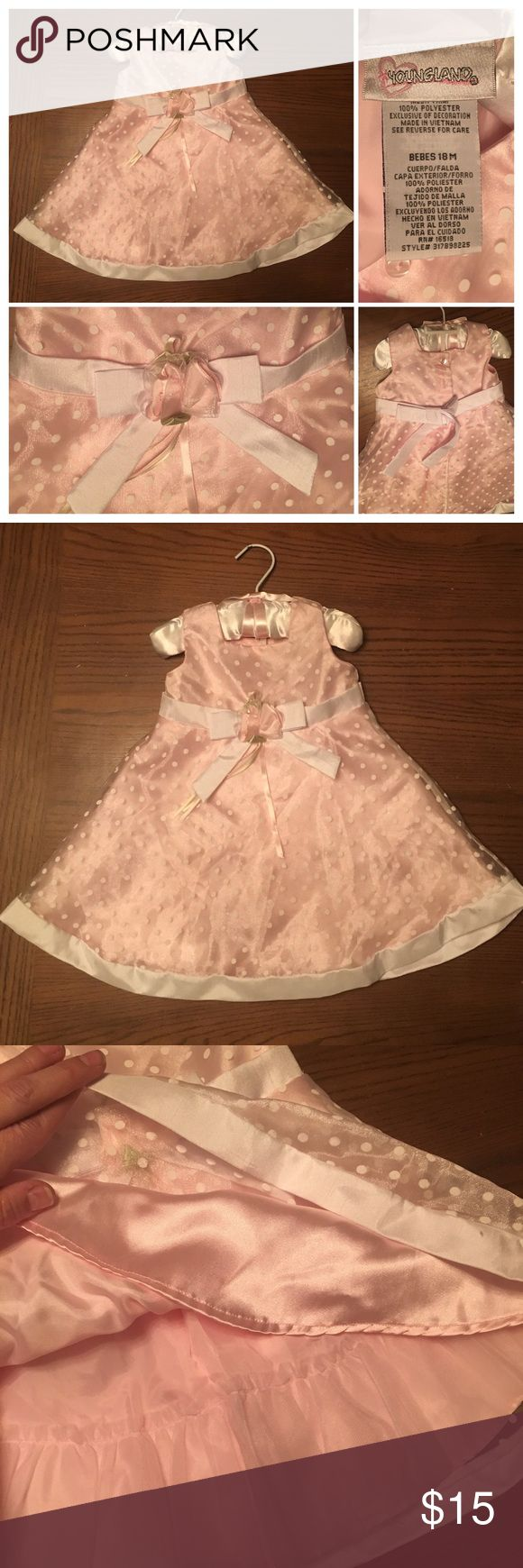 NWOT Size 18M Toddler Girl Party Dress Set! NWOT, this size 18month toddler girl's dress is in unused condition- comes complete with padded, matching hanger and satin diaper cover! Pastel pink as its base color, the dress has a sheer shimmery top layer with white polka dots, over two additional layers of lining and attached petticoat! Beautiful details at the waist, and a tie in back in addition to the buttons! Please see pictures for labels and materials, thank you! Youngland Dresses Formal