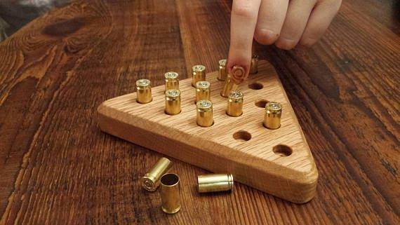 Click for 9 mm Triangle Peg Game, great addition to any man cave,  game room or dorm room.  Makes a great gift for hunters or gun  enthusiasts, military, police or law enforcement.  Great gift for men.