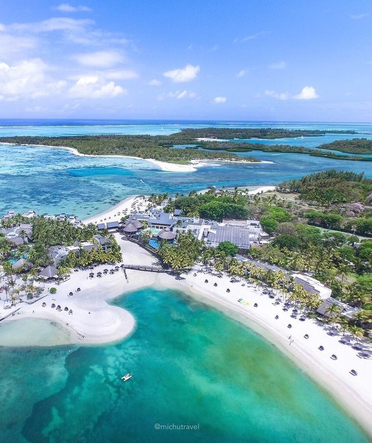 Shangri-La's Le Touessrok Resort & Spa, Mauritius (Indian Ocean Island nation 1200 miles off the southeast Coast off the African Continent ). This photo was taken with a drone above the Shangri-La's Le Touessrok Resort you can also see the famous island of Ile Aux Cerfs and the resort's private island at the back! It's only a 10 mins boat ride to visit these wonderful islands off the coast of East Mauritius. Photo by michutravel via Instagram #amitrips #travel #mauritius #beaches