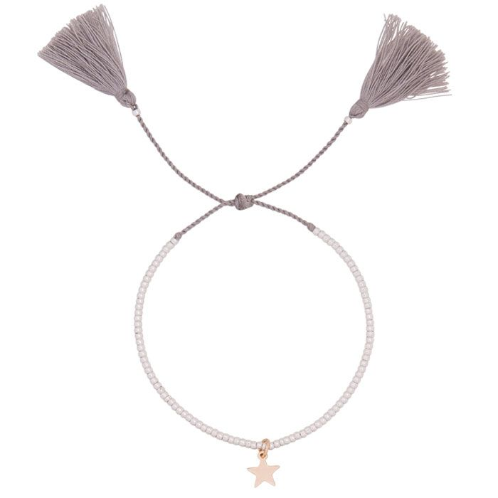 Seriously luxe... the new Estella Bartlett Silver Plated Louise Grey Tassle Bracelet with Gold Star. Featuring tiny silver plated beads combined with a soft grey fabric cord and finished with fabulous tassels. A gold star charm completes the piece.