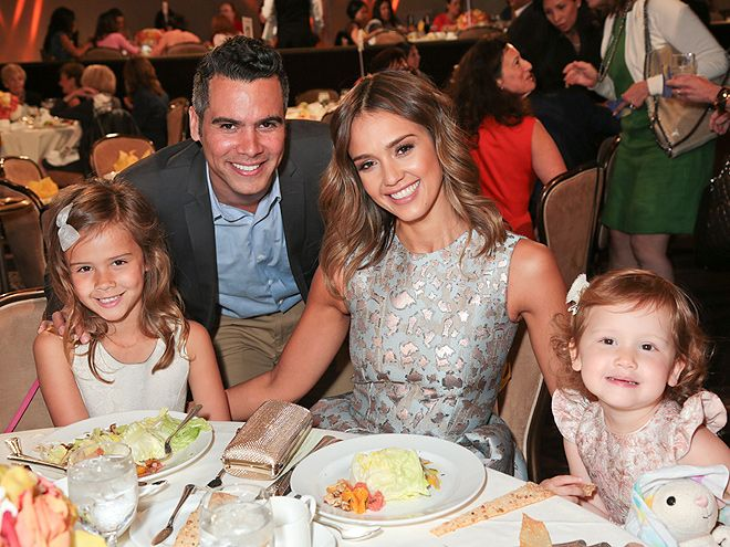 PICTURE PERFECT   | Honest Company founder Jessica Alba makes Friday's Helping Hand of Los Angeles Mother's Day luncheon at the Beverly Hilton Hotel a family affair, posing for a photo with husband Cash Warren and daughters Honor, 5½, and Haven, 2½.