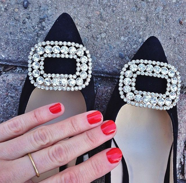 Regal French Buckle Shoelery Shoe Clips with black heels and red manicure