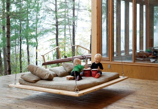 This cool swing-bed resides at a lakeside house in Toronto.