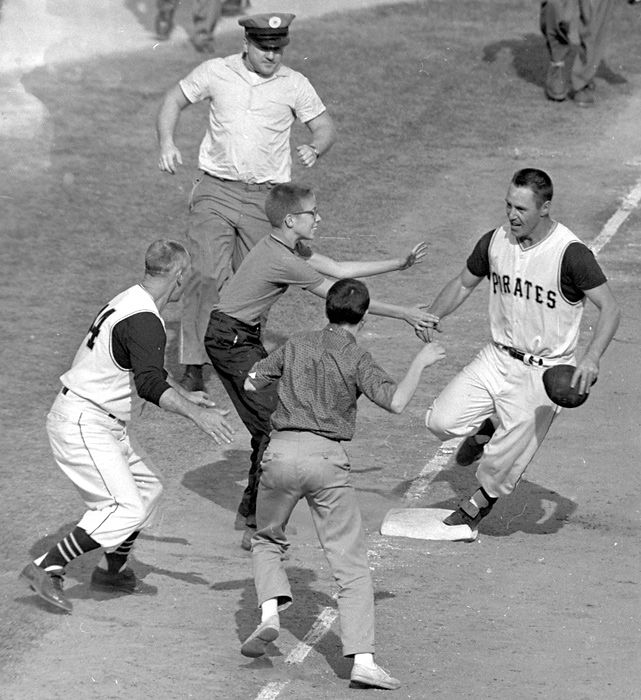 Bill Mazeroski celebrates after hitting a walk-off home run in Game 7 of the 1960 World Series between the Pirates and Yankees. It was the first walk-off home run to win a World Series in baseball history.