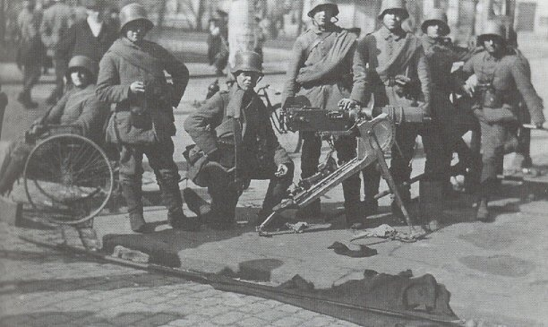 German soldiers after the fall of Helsinki in the Finnish civil war 1918. TheRed Guard Headquarter Smolna´s flag thrown to the street