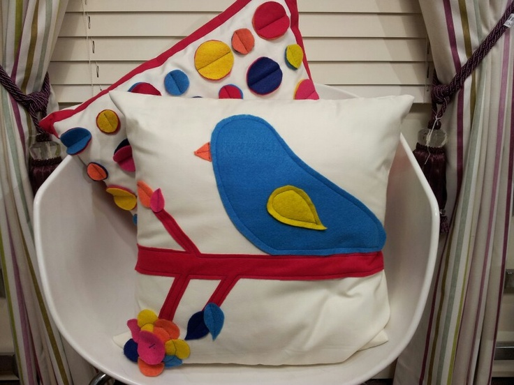 Felt cushion with bird and flower details