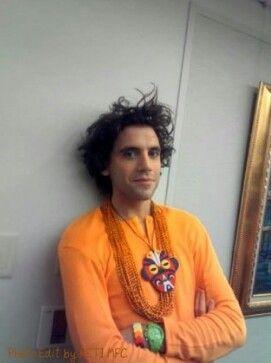 Disheveled Mika in orange shirt: that's how I like my men