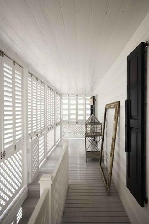 sunny closed in balcony by India Hicks.