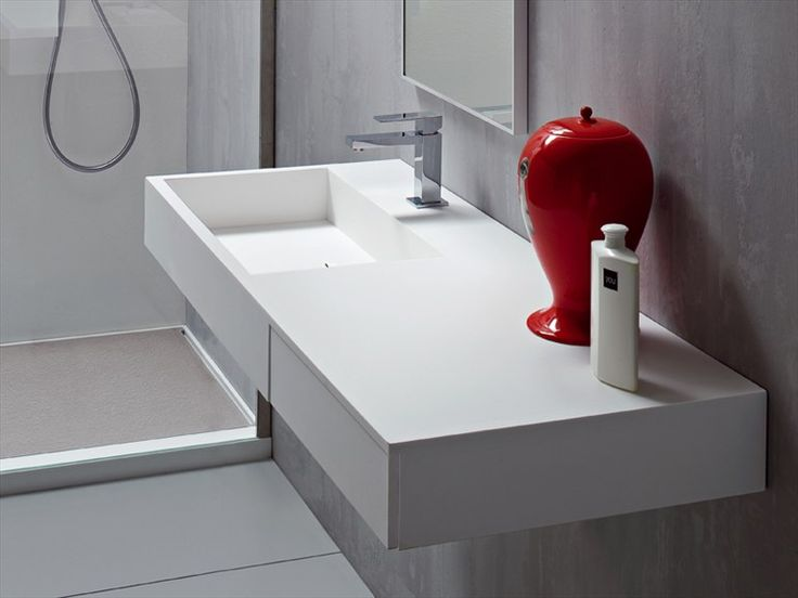 Wall-mounted Korakril™ washbasin with integrated countertop Argo Collection by Rexa Design