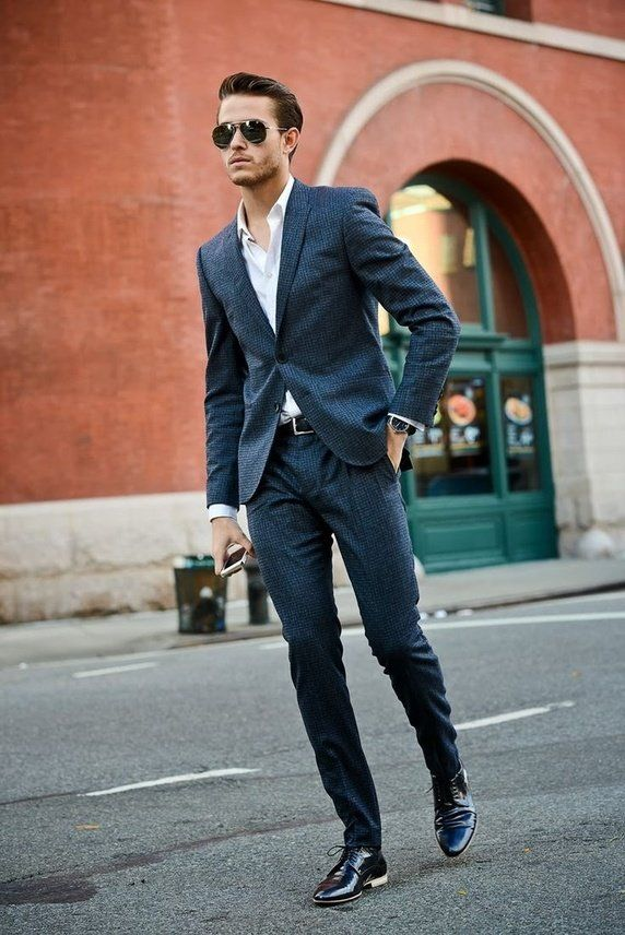 Go for a classic style in a navy wool suit and a white dress shirt. Why not  add black leather derby shoes to the mix for a more relaxed feel?