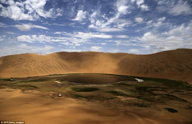 This oasis in the Gobi Desert looked peaceful until competitors in the Silk Way Rally arrived on their journey to Beijing
