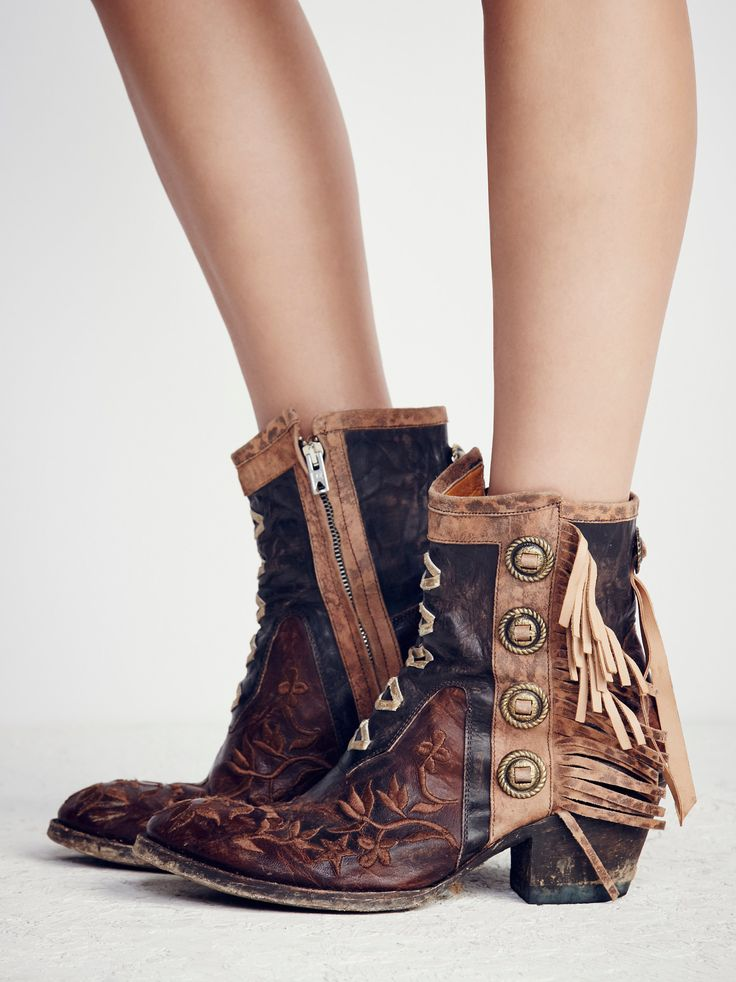 King Ranch Ankle Boot | Western-inspired ankle boots featuring beautiful embroidery detailing with metal accents and statement fringe trim. Round toe and a stacked heel. Inside zipper closure for an easy on/off.