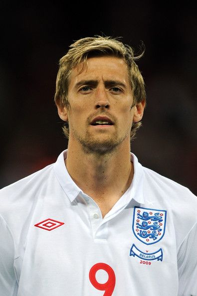 peter crouch'   ... in this photo peter crouch peter crouch of england looks on during the