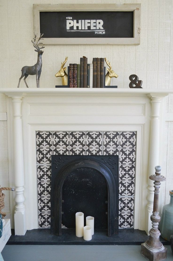 Original fireplace in a Southern fixer upper, repurposed as a decorative accent on the covered porch. Cement Tile Surround