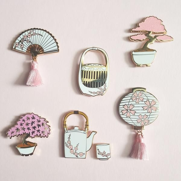 Sakura enamel pin Bundle contains 1 of each of the following pins:  ♥ Lantern ♥ Teapot♥ Teacup♥ Hand Fan ♥ Maple Bonsai ♥ Red Bonsai ♥ Cricket Cage Pink and white enamel with some glitter. Lantern and hand fan come with a pink tassel.         All images are copyrighted © 2017 by Faux Fox Studio. The use of any image from this site is prohibited unless prior written permission from the artist is obtained.