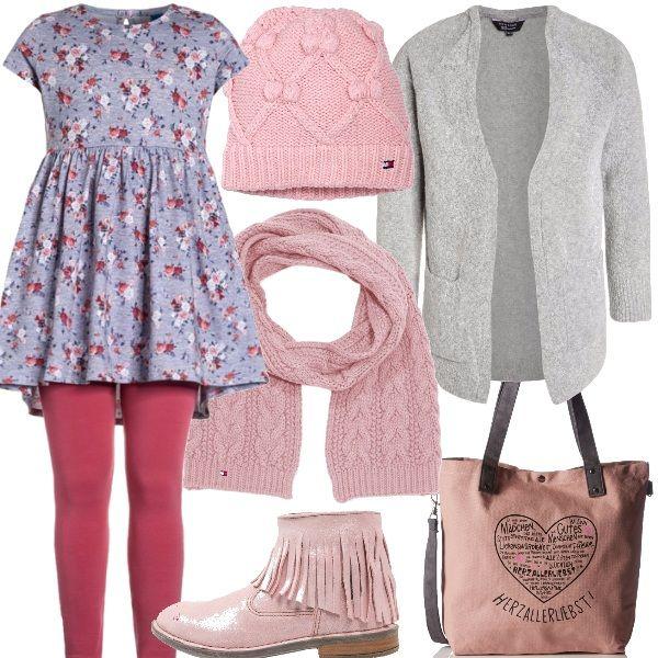 La maglietta taglio impero floreale è molto romantica, forma un completo con i leggings rosa, sopra il caldo cardigan grigio. Gli accessori sono sciarpa e cappello rosa e i tronchetti sempre rosa baby con frange dal sapore etnico. Infine la borsa shopping rosa con manici grigi.