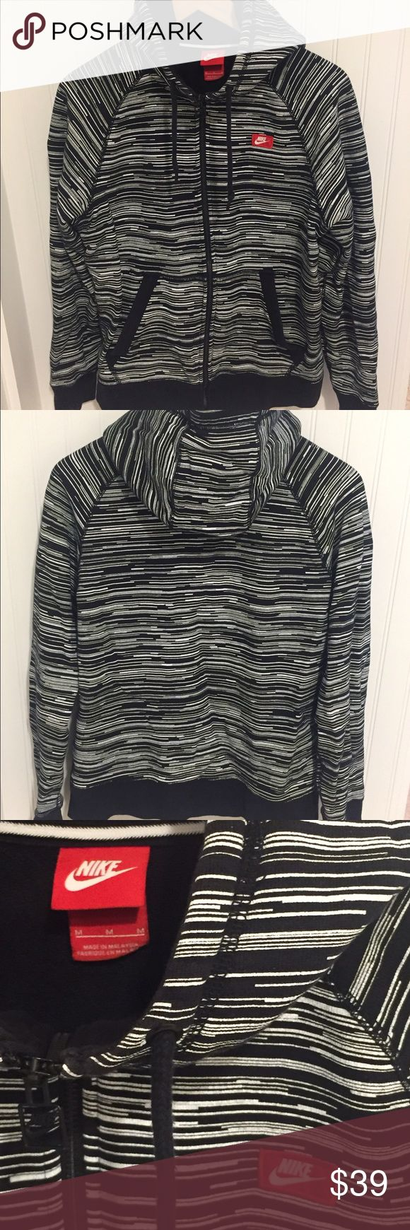 Nike black white stripe hoodie sweatshirt jacket M Size medium. Worn a few times but in excellent condition. See my closet for more great deals on designer items. 15% off a bundle of three or more items. Nike Tops Sweatshirts & Hoodies
