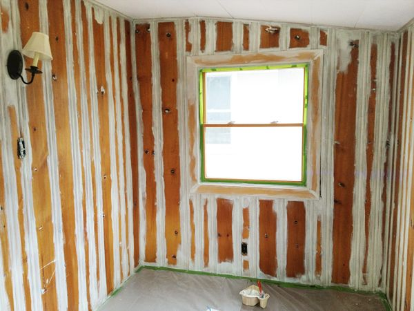 Priming wood paneling be sure to use a heavy duty shellac Ways to update wood paneling
