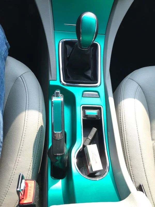 DIY car center console. Tiffany blue vinyl wrap $15 20''x60''.