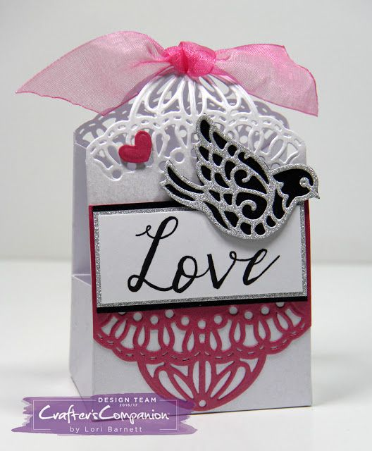 Designed by Lori Barnett. DIY Bag created using Crafter's Companion Doily Corner Dies, Create-A-Card Feathered Friends Die Set, Spectrum Noir Artliner Pen, Shimmer Cardstock, Luxury Glitter Cardstock, Sara Davies Glamour Collection Hot Pink Ribbon, Gemini Die Cutting and Embossing Machine, and The Ultimate. #CraftersCompanion #HSNCrafts #HSN #ItIsFunHere #SpectrumNoir #ArtlinerPens #CreateACard #FeatheredFriends #DIYBag
