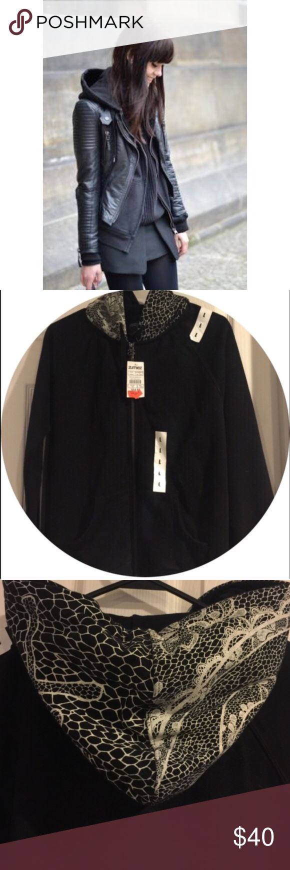 Black Zip Up Hoodie NWT Stussy Hoodie. Solid black with a cream lace design on hood. Never worn! Juniors Large = Women's Small. Cover photo used to show a cute way to style a black zip up sweatshirt. Stussy Tops Sweatshirts & Hoodies