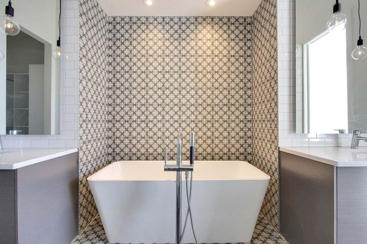 Repeated floor tile pattern up recessed wall - bath space is more intimate part of open bathroom