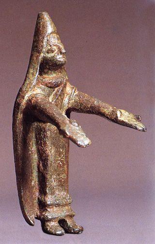 Praying woman with a steep mantilla.  Bronze votive offerings at Castillar  de Santiesteban, 400-100 bce.