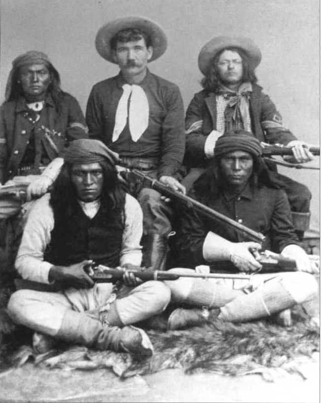 Tom Horn with Mike Free on his left and three unidentified Apache men.