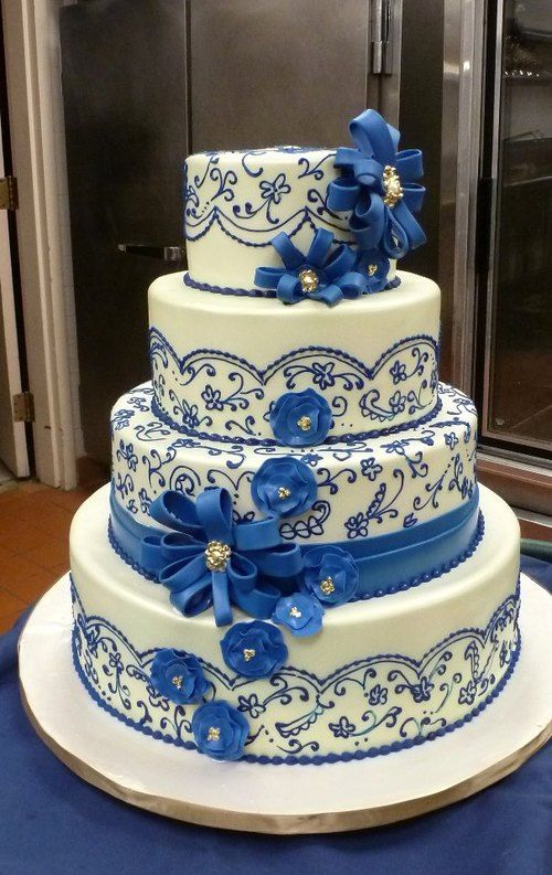 Beautiful wedding cake decorated with blue lace and flowers