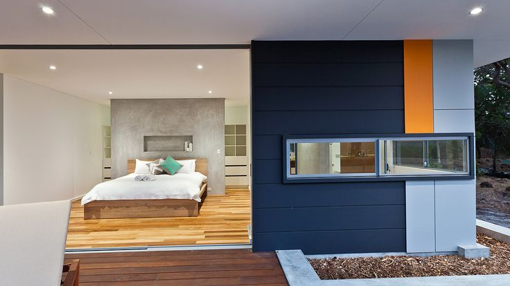 Contemporary bedroom design, glass faced render feature wall, timber flooring, James Hardie Scyon Stria and Matric Cladding