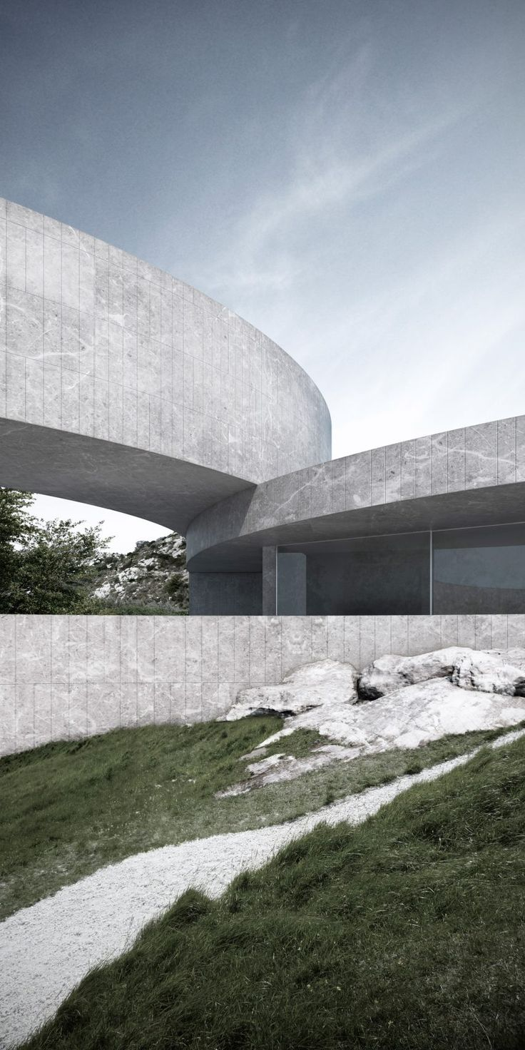 Curving blocks overlap to create the sinuous form of this conceptual house, designed by Fran Silvestre Arquitectos to frame seven tiered gardens in Spain.