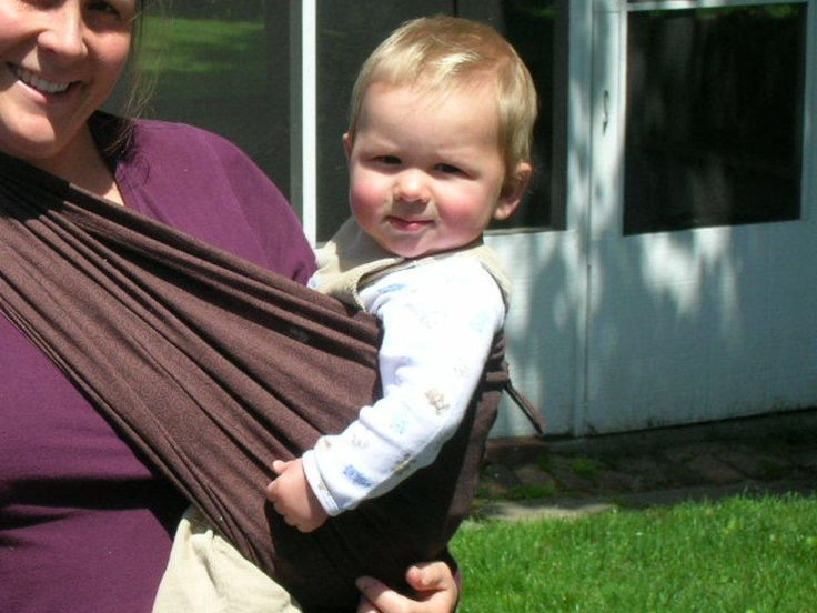 This instructable will show you how to make a peanut shell style baby sling for under $20, (even less depending on your fabric. You can also find similar info on this site http://mykarmababy.com/pages/BabySlingPattern.php