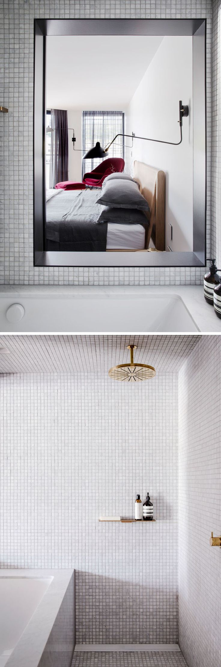 This modern bathroom has a partially open wall next to the bath to allow natural light from the bedroom to fill the space. Light grey tiles and gold hardware have been used to keep the space bright.