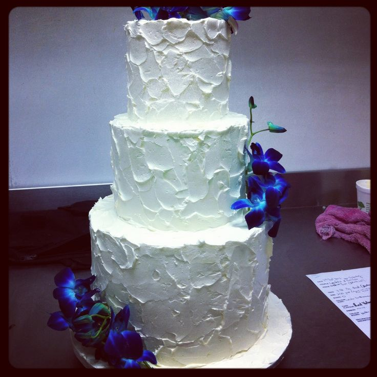 3 tier wedding cake with messy butter cream finish & blue orchids www.casadel.com.au