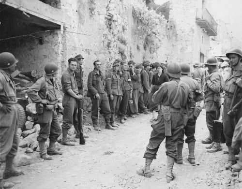 French and American soldiers of the 5th Army guard German POW's, Castleforte, Italy, ca.1944