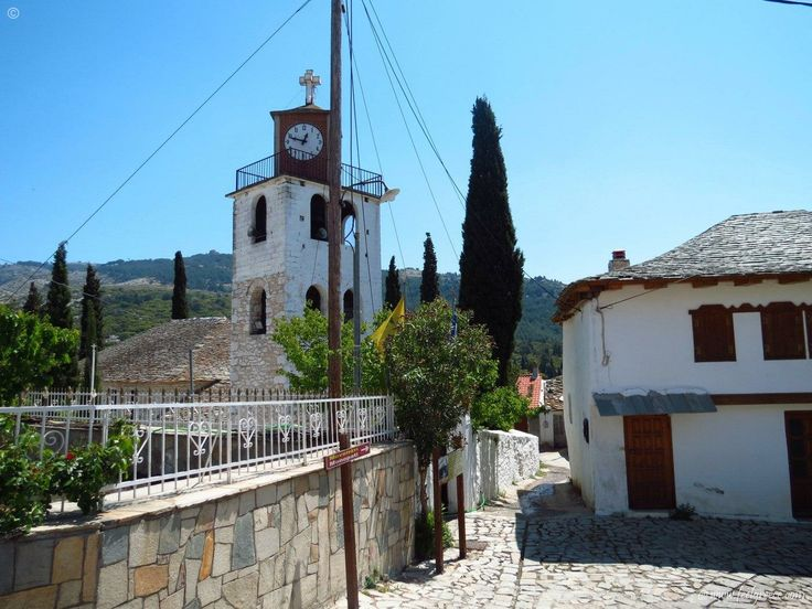 narrow street in Theologos - old village with stone houses and traditional Greek cuisine - Thassos Island