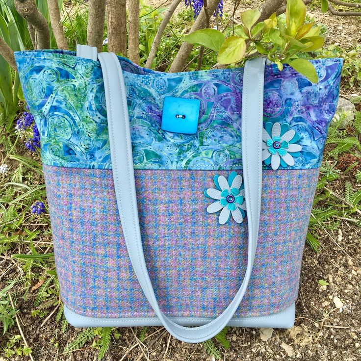 This is SUCH a pretty Bag-it has all my favorite colors! And it will carry SOO much! And the Wool Plaid used to be someone's skirt-til I found this Creative Re-use for it!