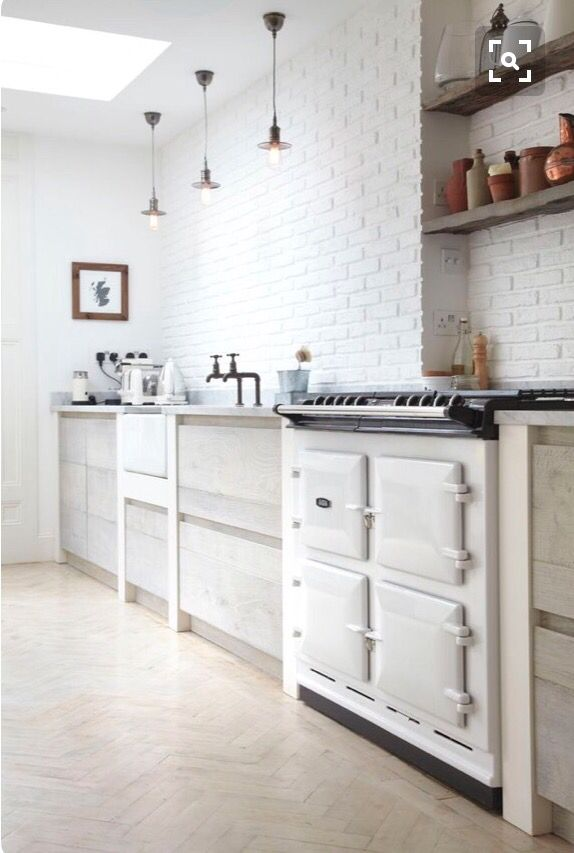 White Faux Brick Wall Panels Used In A Kitchen Design