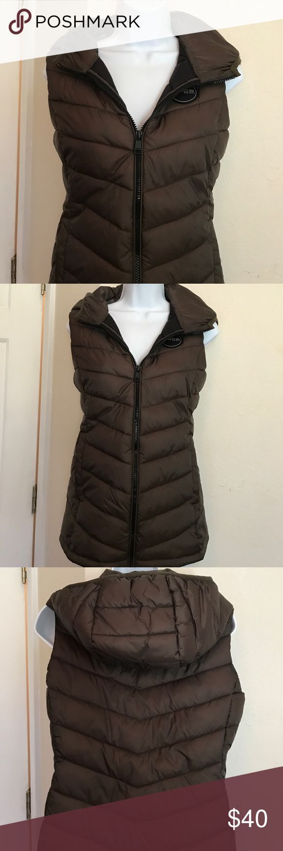 """Ladies Hooded Vest from Bebe Wonderful snug fitting, stylish nylon vest with hood and pockets. Ladies size small/petite Length 25.5"""" Width 18.5"""" under arm & 17"""" waist. bebe Jackets & Coats Vests"""