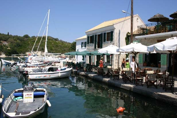 Paxos, Greece: The smallest of the Ionian Islands. A charming landscape of ancient olive groves, punctuated by thick groves of dark cypresses that seem to paint the sky an even brighter blue. #FiveStarGreece #LuxuryVillas #HolidayMatchmakers