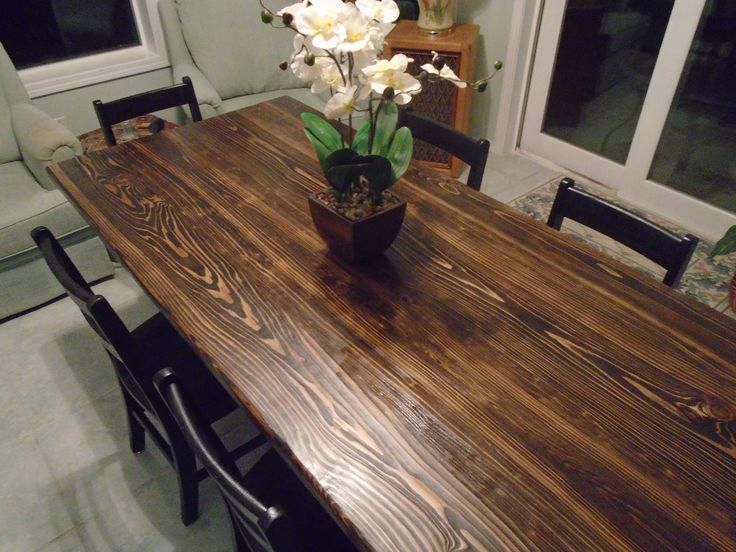Solid Wood Trestle Table With Six Farm Style Black Chairs