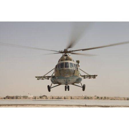 An Afghan Air Force Russian Mil MI-17 helicopter takes off from Camp Shorabak Afghanistan Canvas Art - Stocktrek Images (35 x 23)